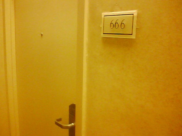 hotel room sign with number 666