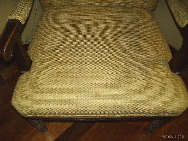 stained upholstered chair