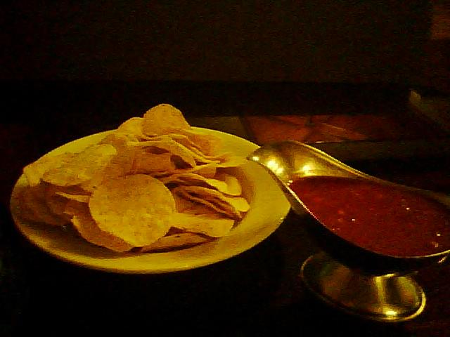 """It wasn't a bad travel day but I missed an exit and spent 45 minutes trying to get turned around in downtown Dallas, so i was ready to sit down and munch and watch some basketball at the bar. """"Nachos with Maria's fresh homemade salsa"""" sounded like a good starter. I got a cereal bowl full of Tostitos and a jar of mild watery Pace in a gravy server. A Holiday Inn in Dallas"""